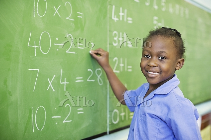 Student writing on blackboard ・・・