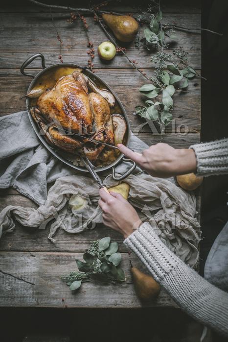 A golden roast chicken with an・・・