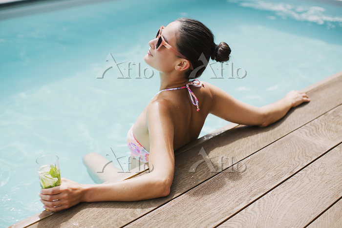 Serene woman with cocktail rel・・・