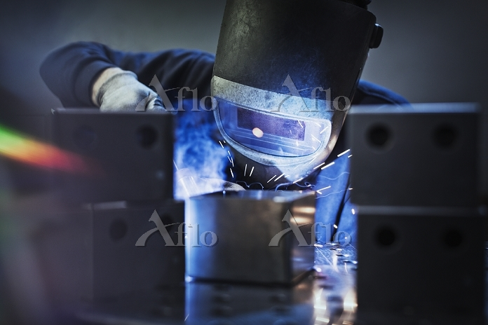 Welder using welding torch on ・・・