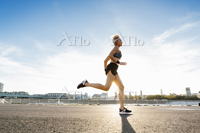 Blonde woman jogging in Cologn・・・