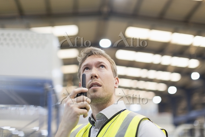 Supervisor using walkie-talkie・・・
