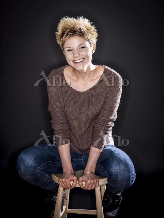 Caucasian woman smiling on ben・・・
