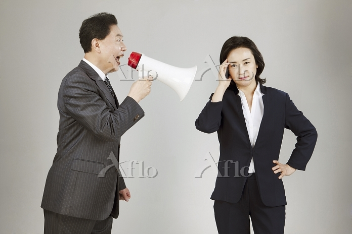 a business man shouting in a m・・・