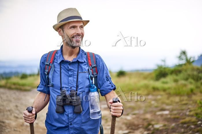 Smiling man with binoculars hi・・・