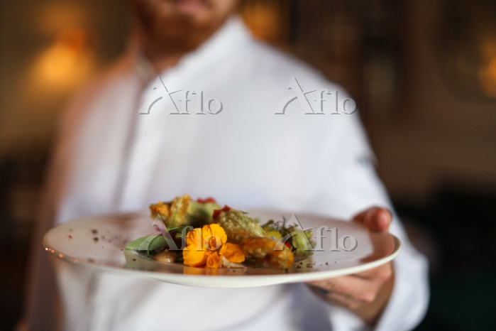 Chef with exotic dish of salad・・・