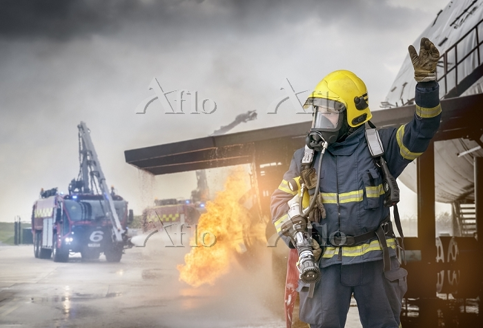 Portrait of fireman in front o・・・