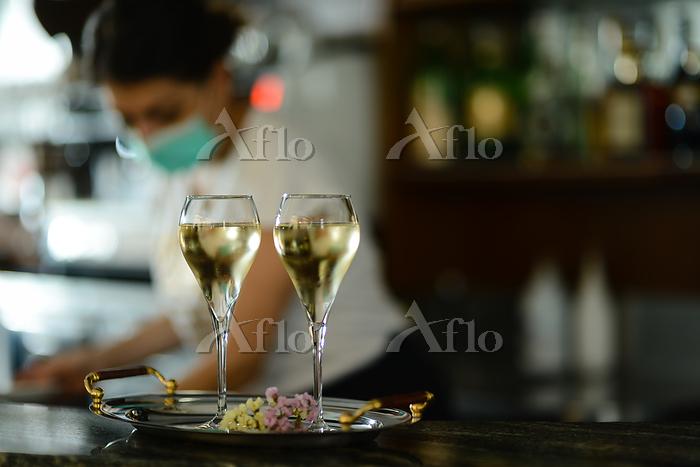 Female bartender wearing face ・・・