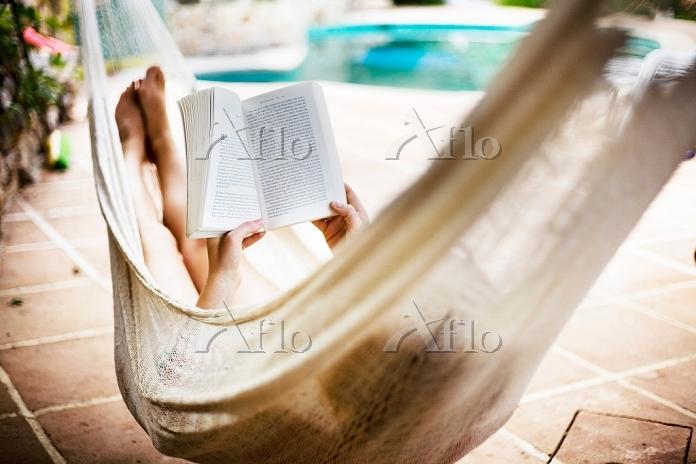 A woman asleep in a hammock