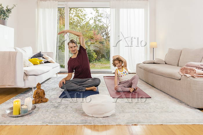 Father and daughter doing yoga・・・