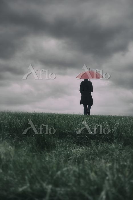 Rearview woman walking on gras・・・