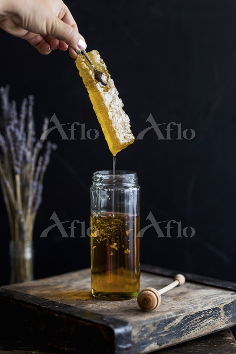 A jar of honey with honeycomb
