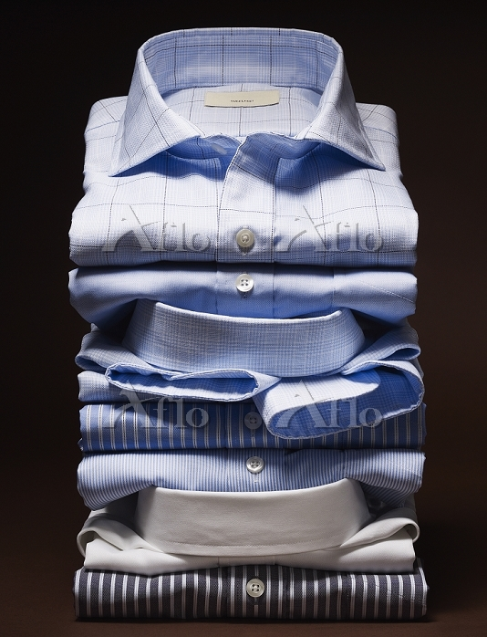 Stack of men's dress shirts on・・・