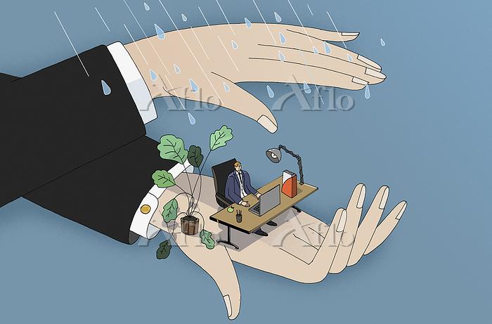 Hands sheltering businessman f・・・