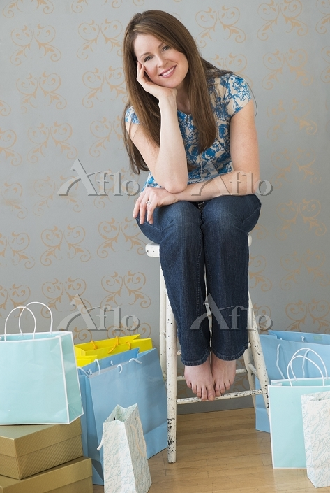 Portrait of woman with shoppin・・・