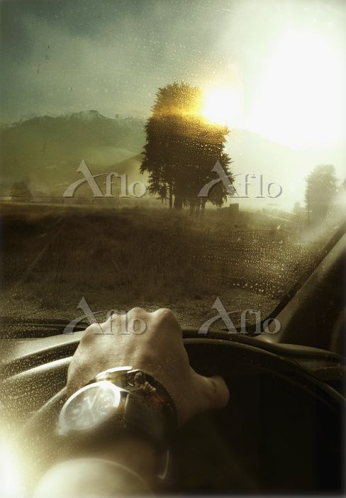 Man driving car in countryside・・・