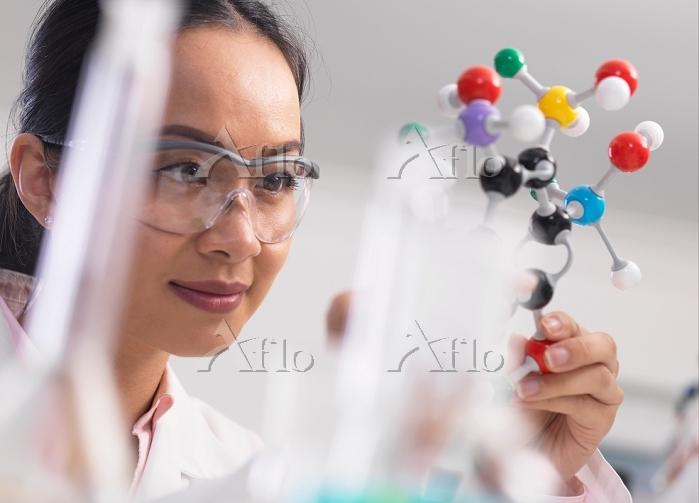 Scientist using molecular mode・・・