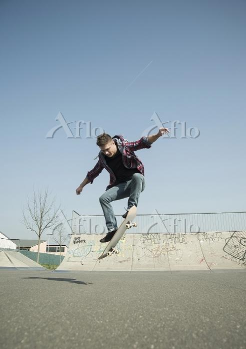 Young man doing skateboarding ・・・