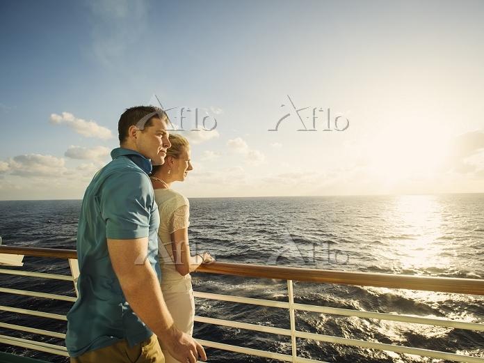 Caucasian couple admiring view・・・