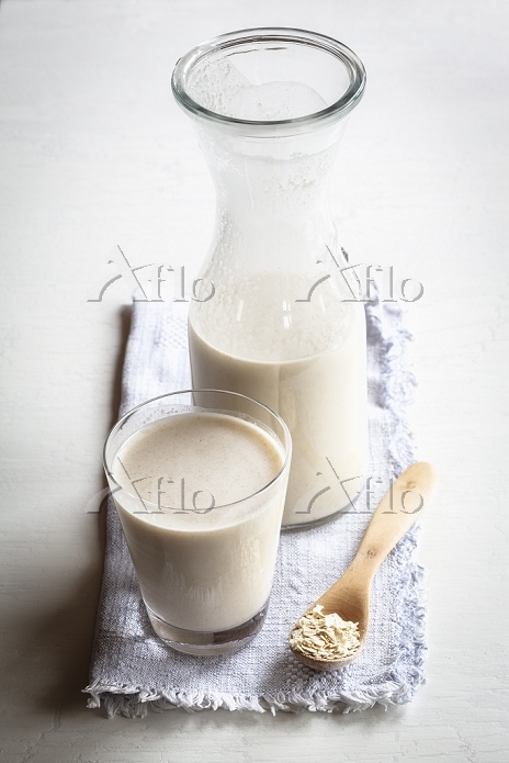 Glass and carafe of oat milk