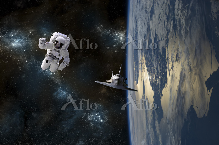 An astronaut drifting in space・・・