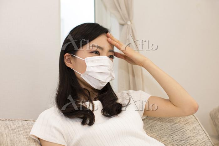 風邪をひいた日本人女性