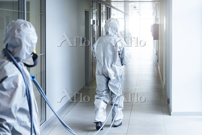 Cleaning staff desinfecting ho・・・