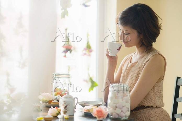 Woman looking down at tea cup