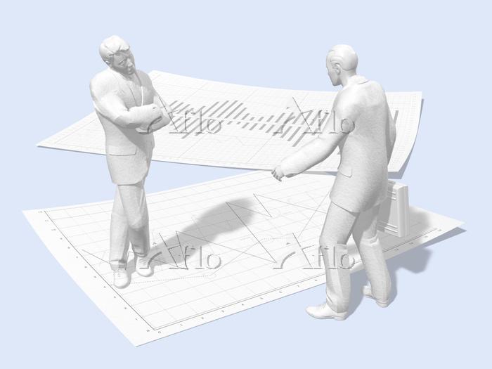 グラフ用紙の上で悩むビジネスマン