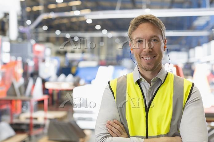 Portrait smiling supervisor in・・・