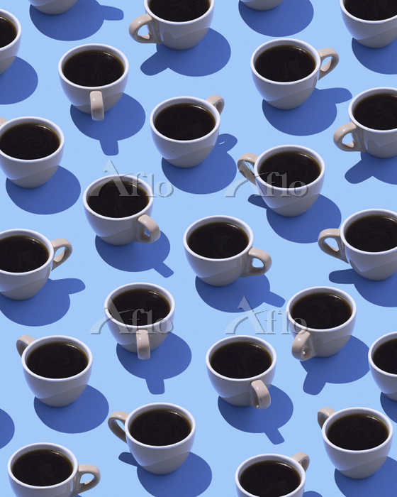 Coffee cups on light blue grou・・・