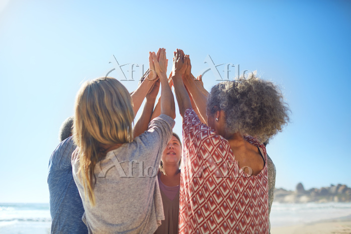 Women friends raising hands in・・・