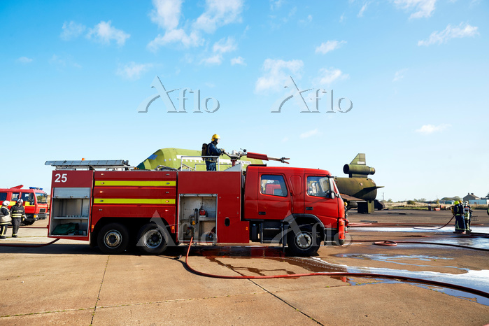 Firemen and fire engine in tra・・・
