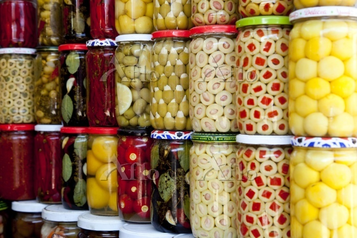 Pickled fruits and olives at a・・・