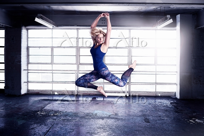 Female dancer leaping in front・・・