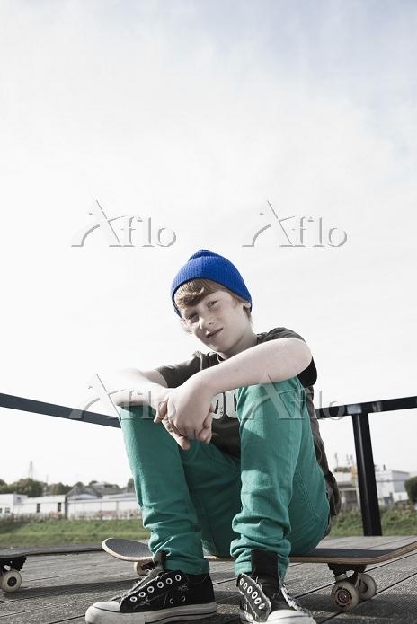 Portrait of Boy Sitting on Ska・・・