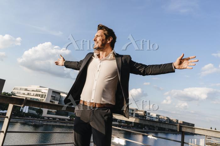 Happy businessman standing on ・・・