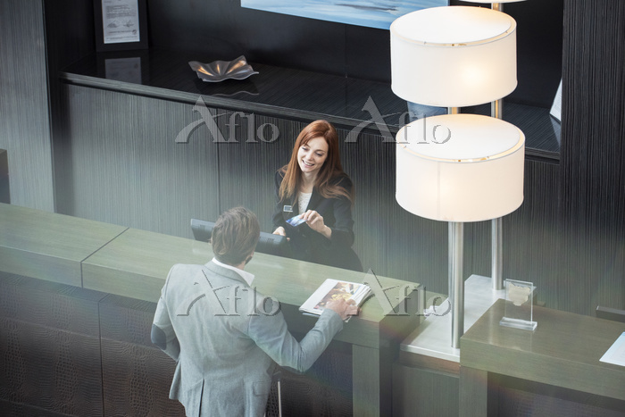 Female receptionist giving cre・・・