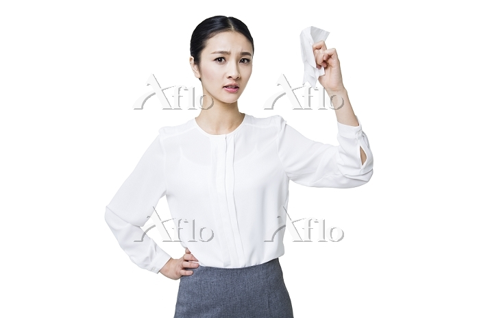 Young woman wiping sweat