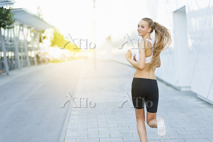 Woman jogging in the city and ・・・