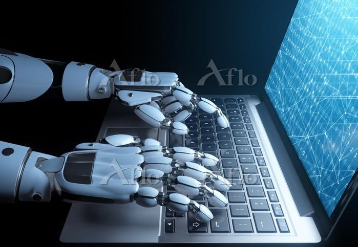 Robot writing a programming co・・・