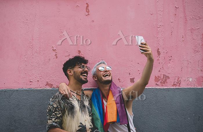 Gay couple taking a selfie in ・・・