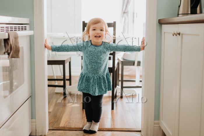 Female toddler standing in kit・・・