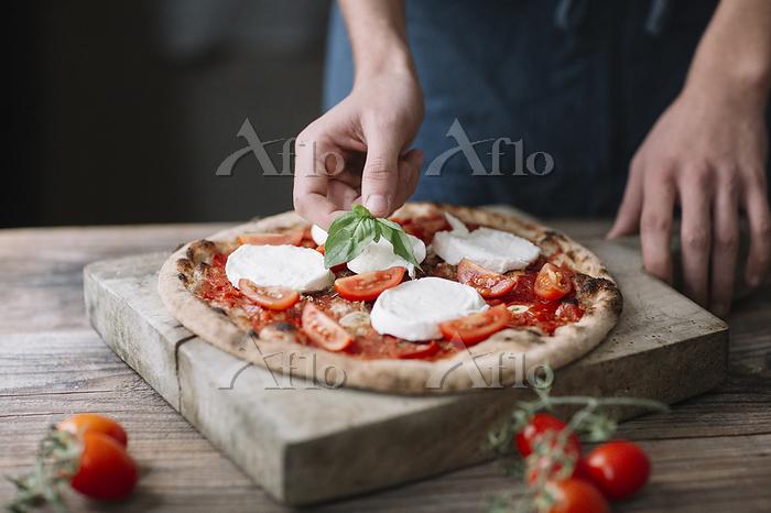 Young man preparing pizza