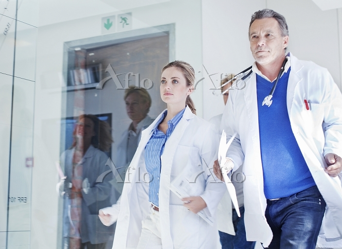 Group of doctors rushing along・・・