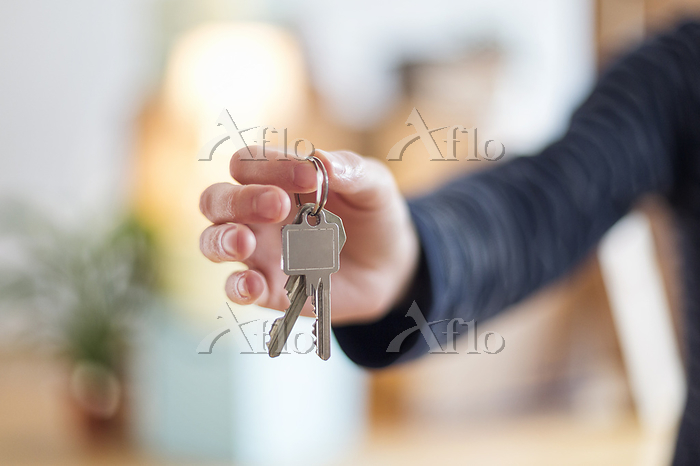 Close-up of man holding house ・・・