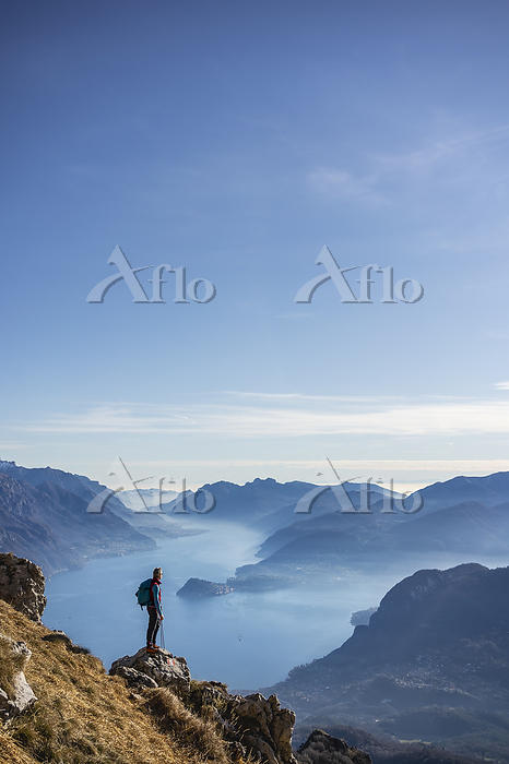 Hiker standing on mountain, lo・・・
