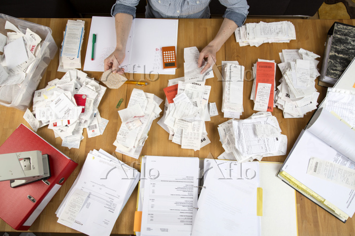 Woman sorting documents, recor・・・