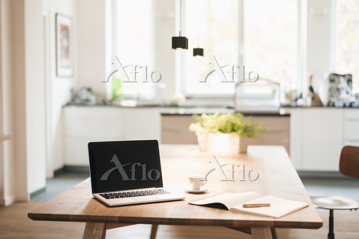 Laptop and notebook on table a・・・