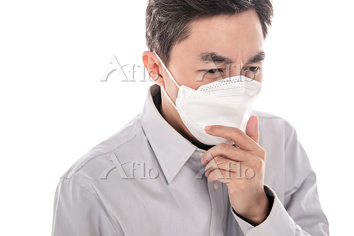 Sick middle-aged man wearing a・・・